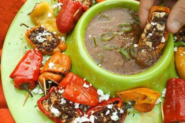 Mini Stuffed Peppers with Chorizo, queso fresco, scallions, garlic and served with a tomato serrano sauce. | mexicanappetizersandmore.com