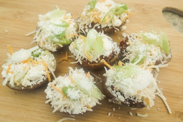 Potato Skins topped with chorizo, queso fresco, cojita cheese, mexican four cheese, sour cream and scallions. | mexicanappetizersandmore.com