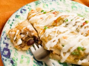 Cheesy Beef Enchiladas in Green Sauce