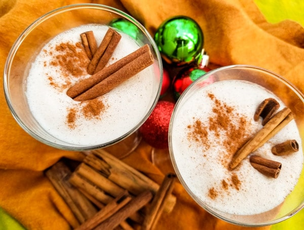 A delicious coquito recipe-coconut eggnog made with evaporated milk, coconut milk, cream of coconut, sweetened condensed, vanilla and cinnamon. Served with or without rum. Creamy and absolutely delicious! | mexicanappetizersandmore.com