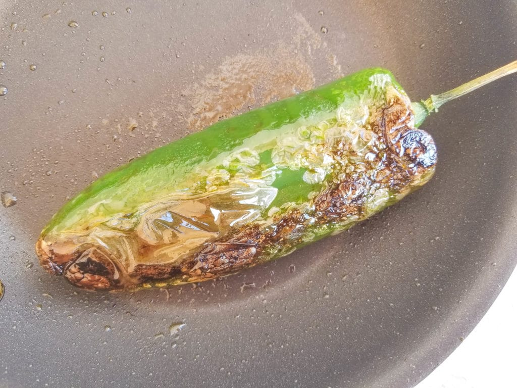 Roasting poblano pepper for Authentic Migas Recipe | mexicanappetizersandmore.com