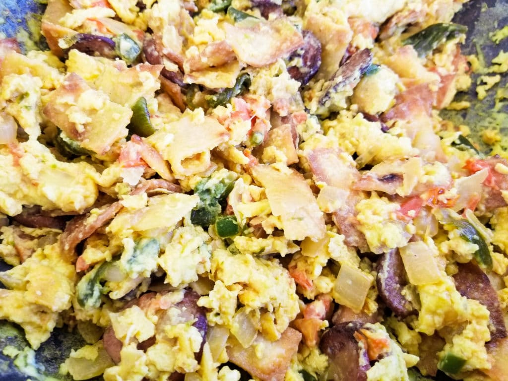 Eggs, veggie mixture and tortilla strips for authentic migas recipe. | mexicanappetizersandmore.com