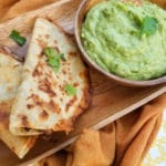 Crispy Black Bean Tacos made with black beans, tomato sauce, red onions, garlic. jalapeno, smoky spices, pepper jack cheese, wrapped in a crispy corn tortilla and served with avocado cilantro sauce. | mexicanappetizersandmore.com