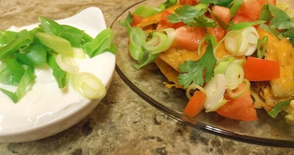 Spicy Jalapeno 3 Layered Mexican Pizza Wedges served with sour cream and scallions.