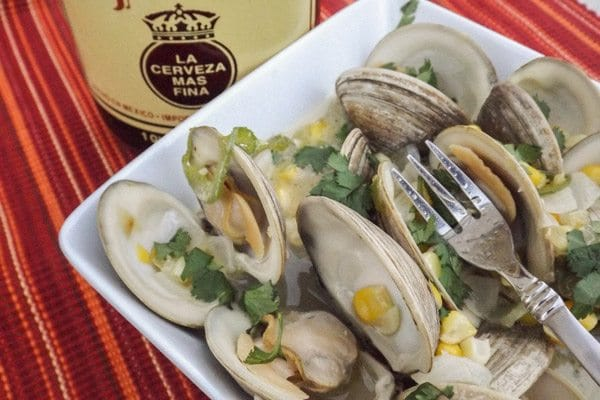 Mexican Beer Little Neck Clams served in a white square bowl.