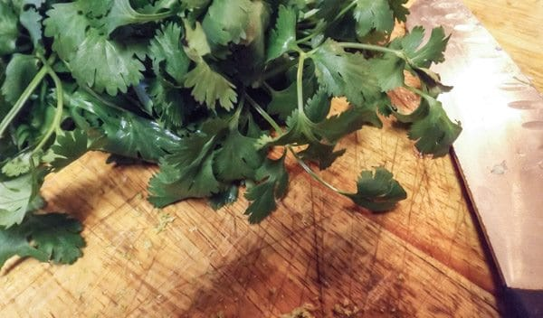 Chopping parsley for the Mexican Beer Little Neck Clams