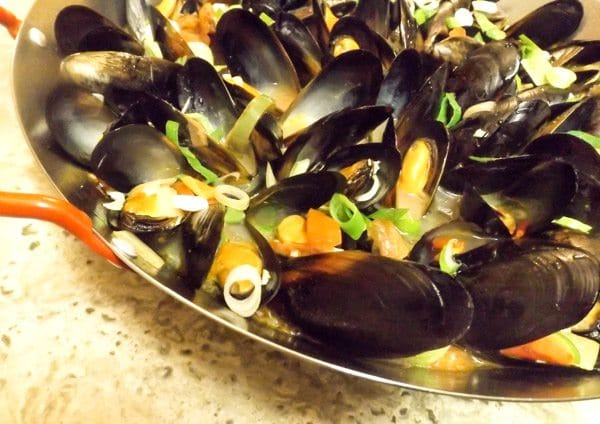 Cooked Mexican Mussels In White Wine served in a paella skillet