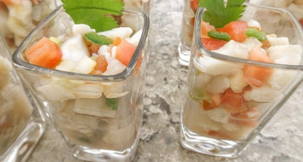 Tilapia Ceviche served in shot glasses.