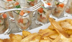Tilapia Ceviche served in small shot glasses with a side of long plantain chips.