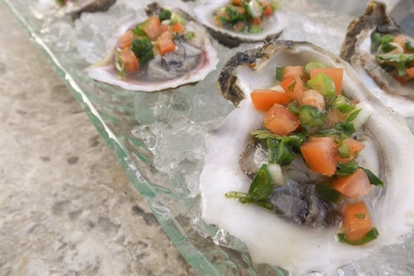 Yemaya's Oysters-freshly shucked oysters sitting on a bed of crushed ice.