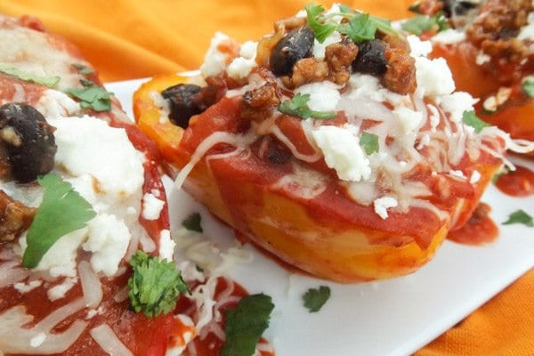 Amazing, delicious Mexican Stuffed Peppers served on a white platter.