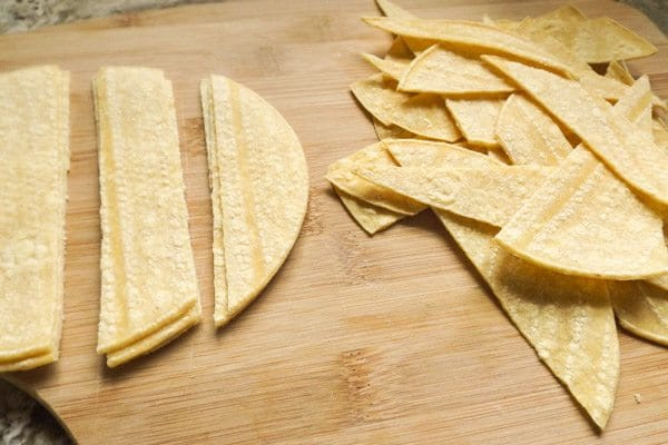 Cutting corn tortillas for Seven Layer Bean Dip