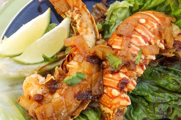 These Chipotle Lobster Tails are so succulent and delicious.  Cooked in a savory chipotle garlic broth. Two Chipotle Lobster Tails served on a blue platter