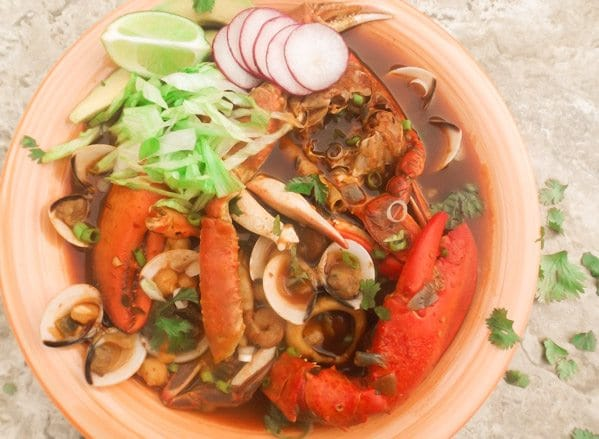 Pozole de Mariscos (Seafood Pozole) Seafood broth has clams, calamari, scallops, shrimp, snow crab, blue crab, lobster, white hominy and seasoned with Mexican pepper chilis, garlic and spices. Excellent soup!