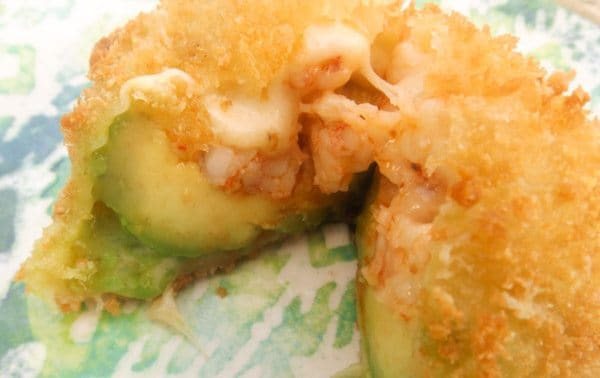 Fried Avocado Stuffed with Shrimp served on a blue and green plate.