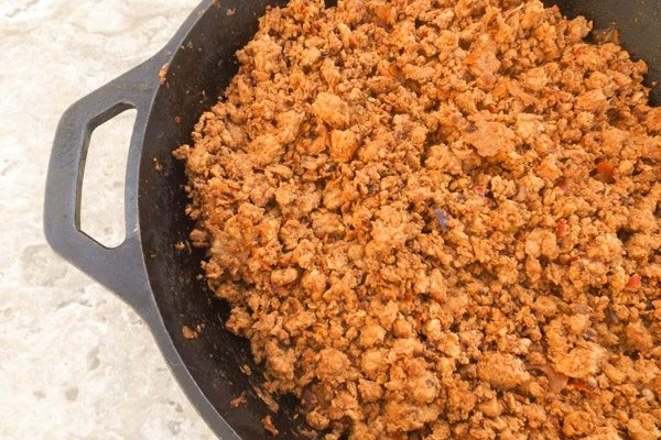 Cooked ground turkey chorizo in cast iron skillet for Molletes Mexicanos