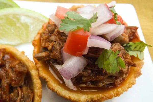Beef chilapita with chopped red onions, tomatoes and cilantro topping-Chilapitas Mixtos