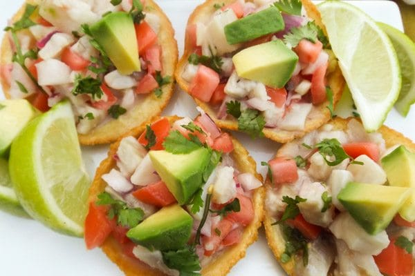 Ceviche Chilapitas on white platter with limes-Chilapitas Mixtos