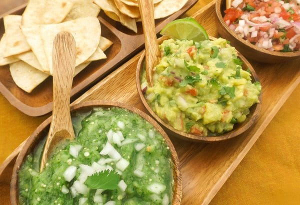 Slsa verde, guacamole and pico de gallo served in wooden dip bowls with homemade tortilla chips-Chips and Dip