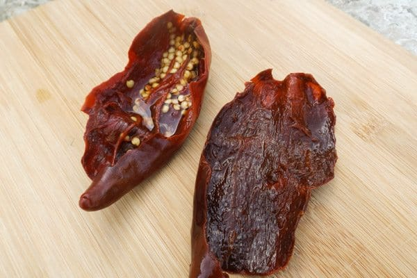 Chile Guajillo pepper on wooden cutting board-Beef Mexican Tamales