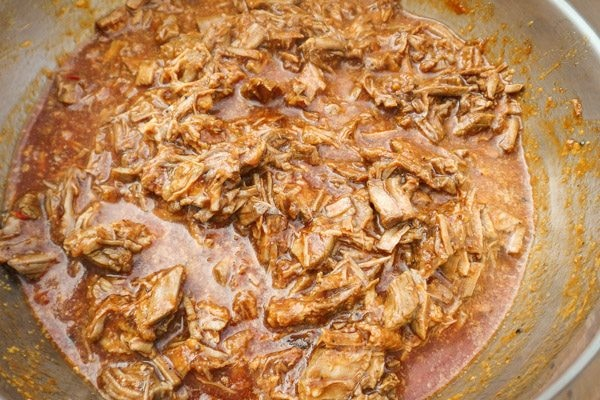Shredded beef with chile red sauce in a bowl-Beef Mexican Tamales