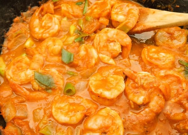 Camarones al Chipotle (Chipotle Shrimp or Spicy Chipotle Shrimp) cooking in a skillet.