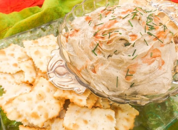 Smoked Oyster Dip served in a glass bowl and a platter of crackers.