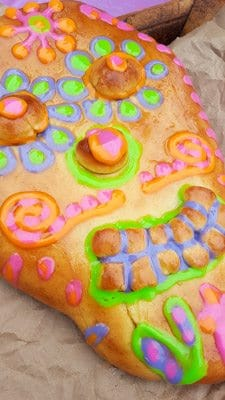 Skull Bread decorated with different colored glazes-Day of the Dead Bread