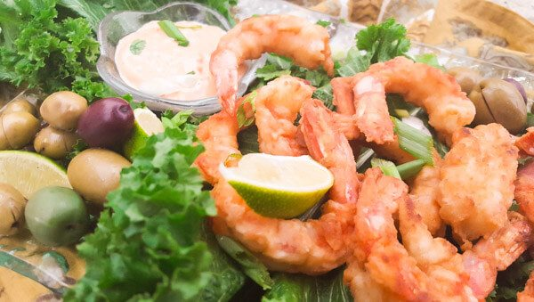 Camarones Fritos Con Crema de Chipotle (Fried Shrimp with Creamy Chipotle Sauce) served on a bed of lettuce with creamy chipotle sauce dip.