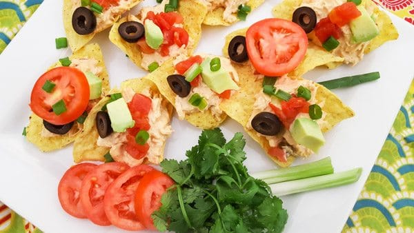 Chicken Tinga Tostaditas served on a white platter.