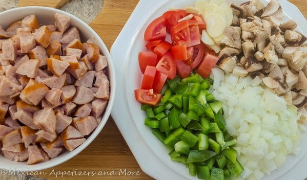 Kielbasa sausage cubed and all veggies for kielbasa in chipotle dip.