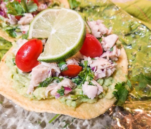 Albacore Tuna Ceviche served on a corn tostada.
