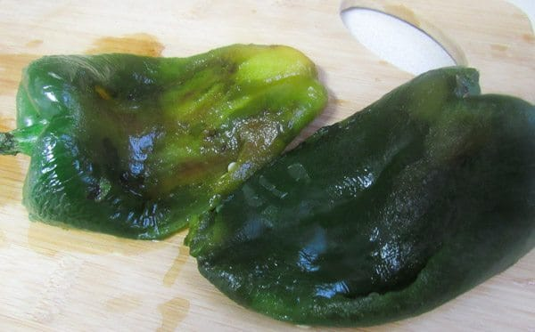 After skin has been removed off of poblano peppers for Tacos Rajas Poblanas