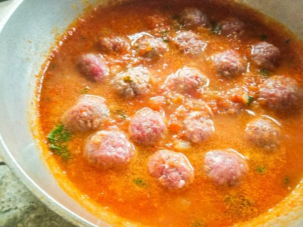 Meatballs cooking in chipotle sauce for Albondigas en Salsa de Chipotle-Meatballs in Chipotle Sauce.