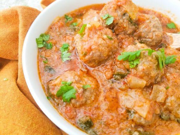 Albondigas en Salsa de Chipotle-Meatballs in Chipotle Sauce in white bowl.