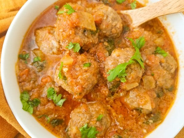 Albondigas en Salsa de Chipotle-Meatballs in Chipotle Sauce served in a white bowl.