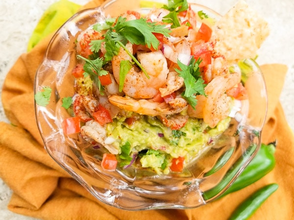 A delicious combination of seafood meets guacamole.  Serve Seafood Guacamole with tortilla chips and have yourself an excellent appetizer. Served in a beautiful glass dish.