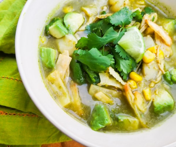 Healthy Chicken Tortilla Soup Recipe served in a white bowl.