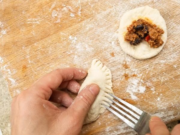 Forming empanadas-Spicy Black Bean Empanadas