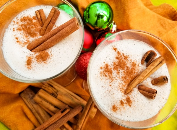 A delicious coquito recipe-coconut eggnog made with evaporated milk, coconut milk, cream of coconut, sweetened condensed, vanilla and cinnamon. Served with or without rum. Creamy and absolutely delicious!