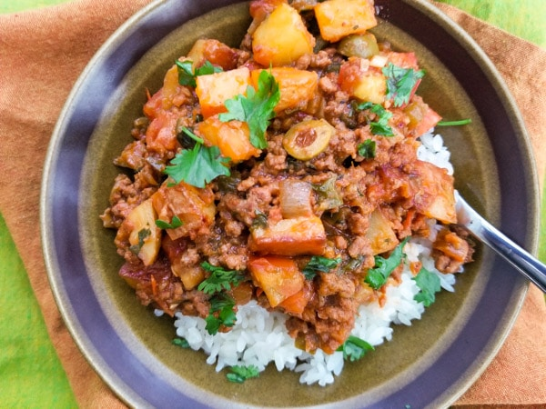Authentic Mexican Picadillo Recipe with potatoes on top of white rice.