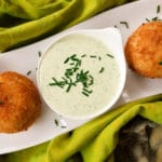 Stuffed Potato Balls, are stuffed with a savory picadillo or beef ground meat and fried leaving a crusty balance and perfectly moist on the inside served with a poblano dipping sauce.
