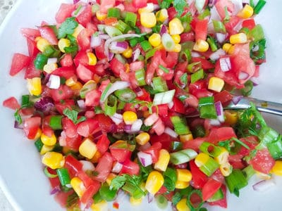 Corn pico de gallo mix in a white bowl for the vegetarian tostadas with corn pico de gallo.