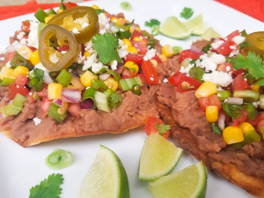 Vegetarian Tostadas with Corn Pico de Gallo served on a white platter.