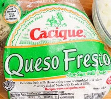 Queso fresco for the vegetarian tostadas with corn pico de gallo.