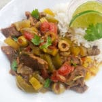 Ropa Vieja Crockpot Recipe served with white rice on a white plate.