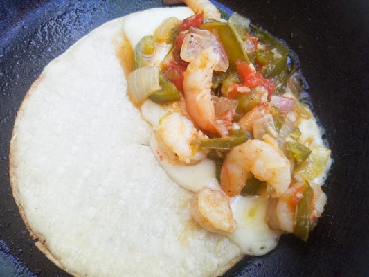 Shrimp mixture on top of cheesy side of corn tortilla- Tacos Gobernador