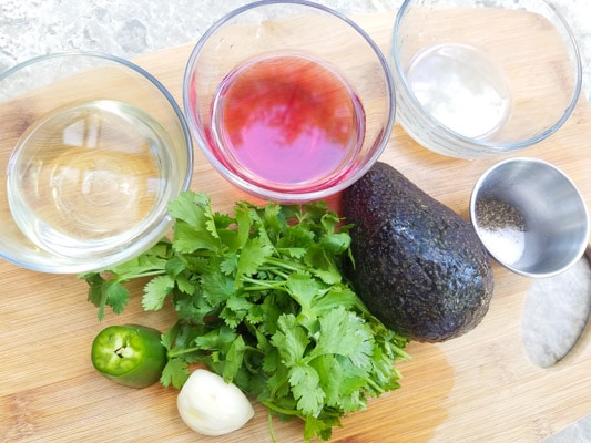 Ingredients for the Avocado Lime Dressing on a cutting board.