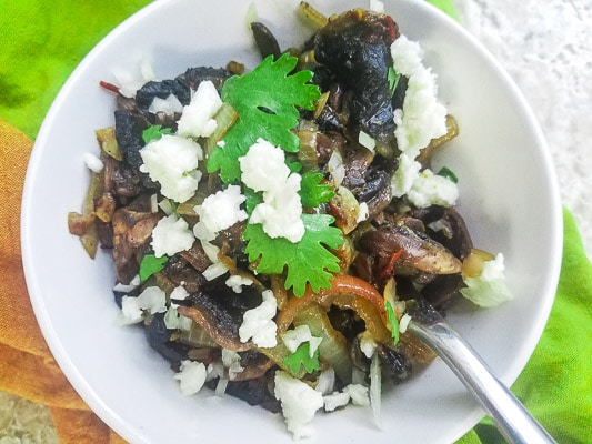 Mexican Chipotle Mushrooms topped with fresh cilantro and queso fresco. Yummy Mexican Mushrooms!