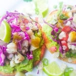 Cauliflower Ceviche Tostadas served on a white plate.